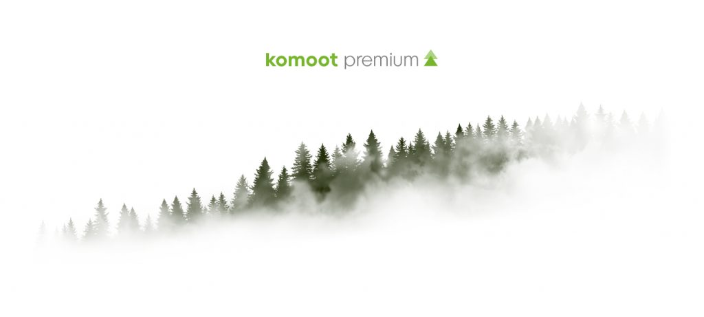 Komoot Premium logo with foggy tree tops